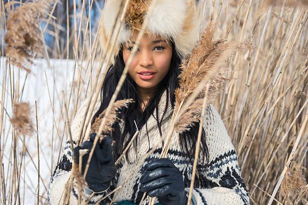 portrait of one young woman in a meadow in winter - moda de invierno fotografías e imágenes de stock