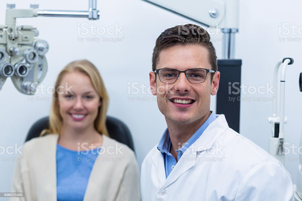 Portrait of optometrist and female patient stock photo