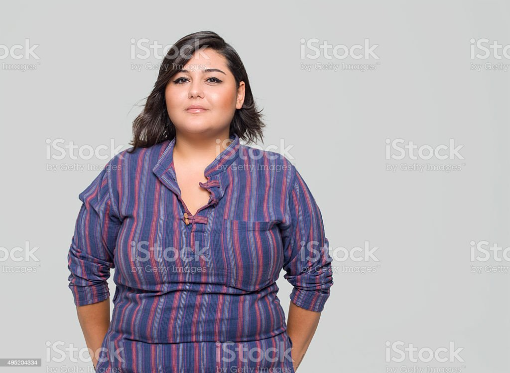 Portrait of overweight woman smiling stock photo