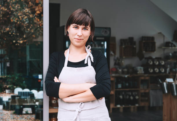 Portrait of owner of sustainable small local business. Shopkeeper of zero waste shop standing on interior background of shop. stock photo