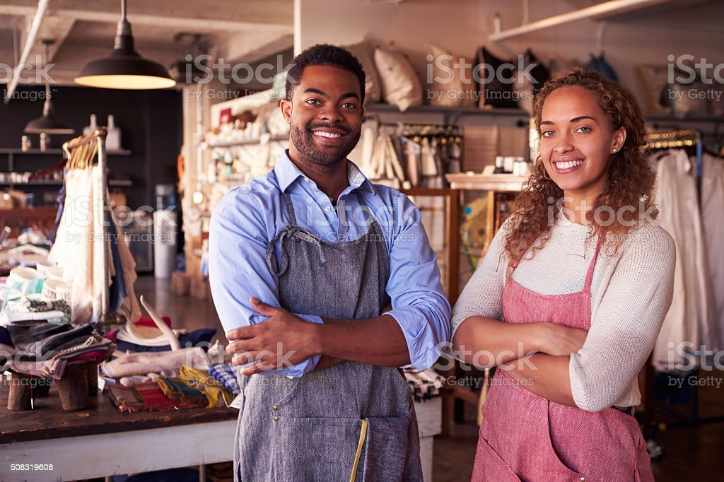 Portrait Of Owners Standing In Gift Store stock photo