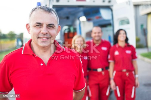 istock Portrait of Paramedic Workers in front an Ambulance 450165017