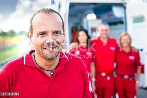 istock Portrait of Paramedic Workers in front an Ambulance 471935189