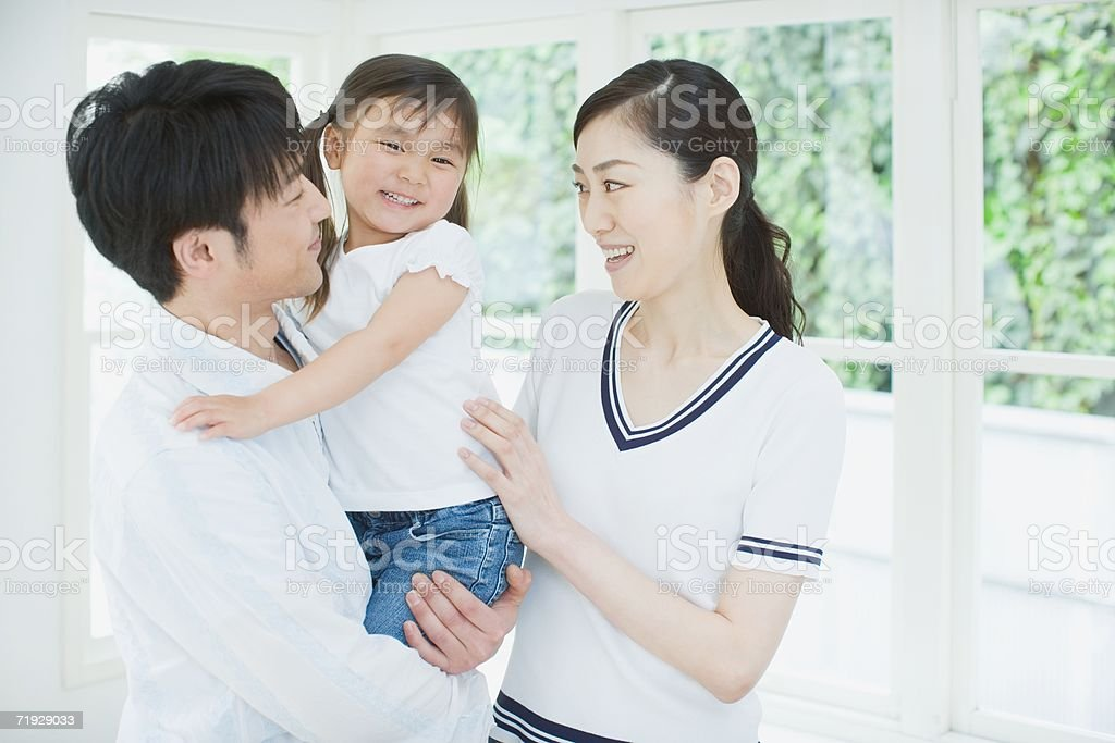 Portrait of parents with daughter royalty-free stock photo
