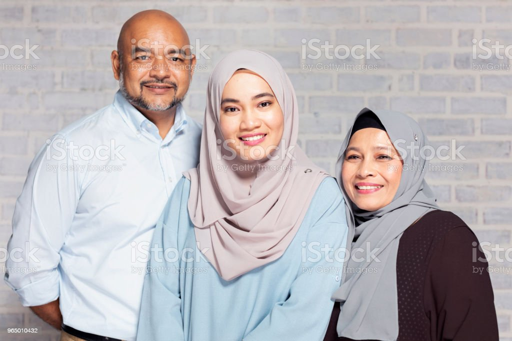Portrait of parents with their daughter stock photo