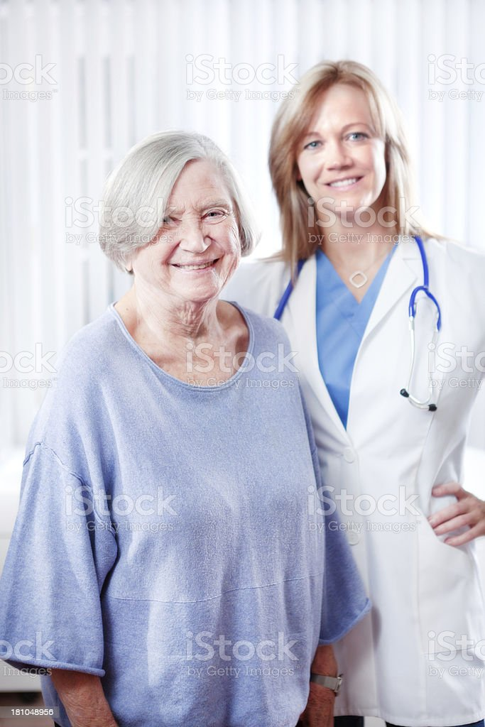 Portrait of Patient and Physician in Medical Clinic Office Vt royalty-free stock photo
