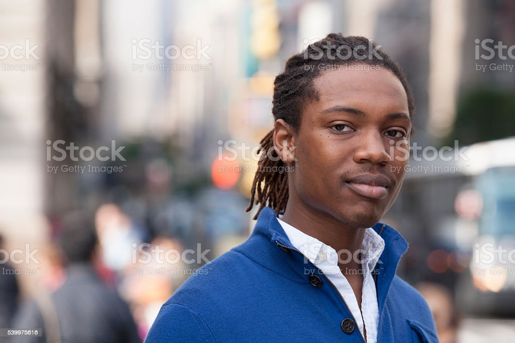 Portrait of pedestrian in city stock photo