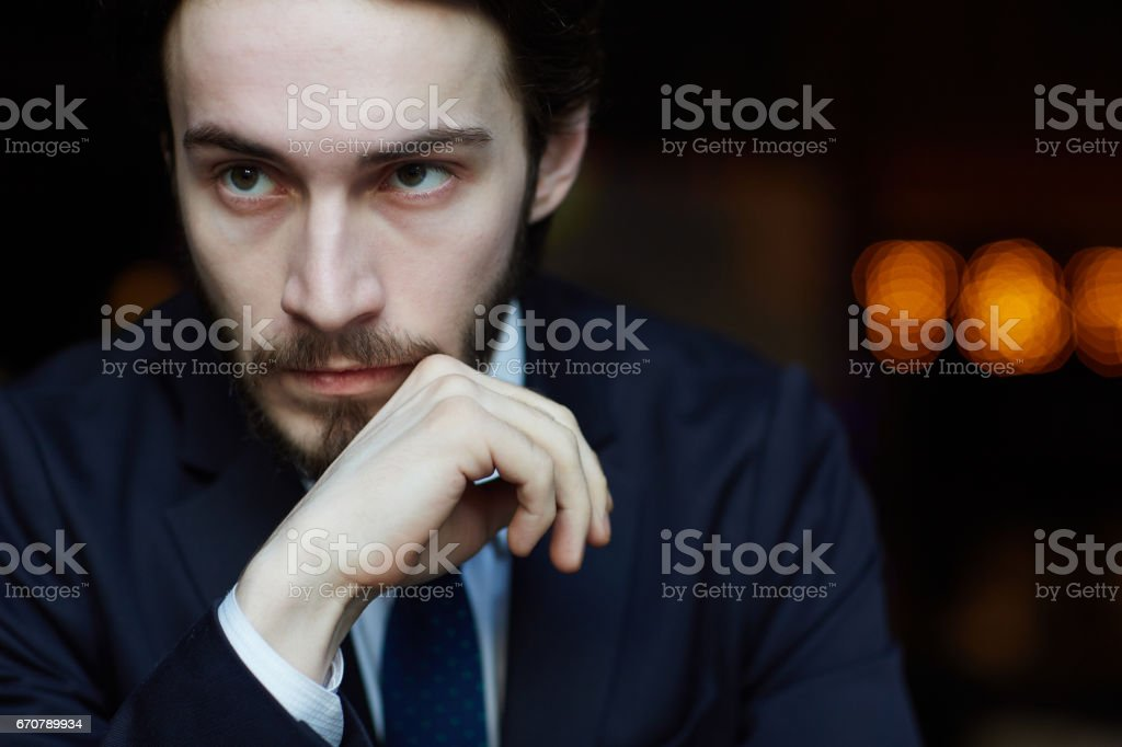 Portrait of Pensive Elegant Man stock photo