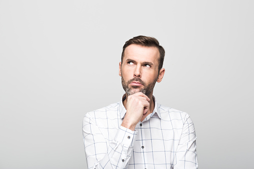 Portrait Of Pensive Handsome Man Grey Background Stock Photo - Download Image Now