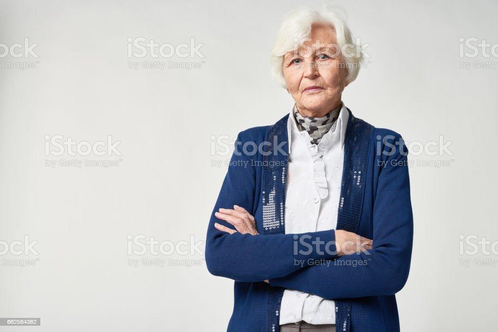 Portrait of pensive senior woman stock photo