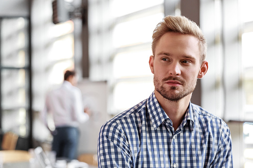 Portrait Of Pensive Young Businessman In The Office Stock Photo - Download Image Now