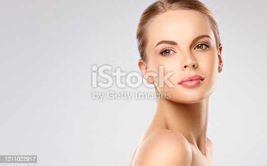 Portrait of mature woman with sincere look of blue eyes. Light smile on the perfect face  and  elegant turn of the head. Facial treatment, cosmetology, beauty technologies and spa.