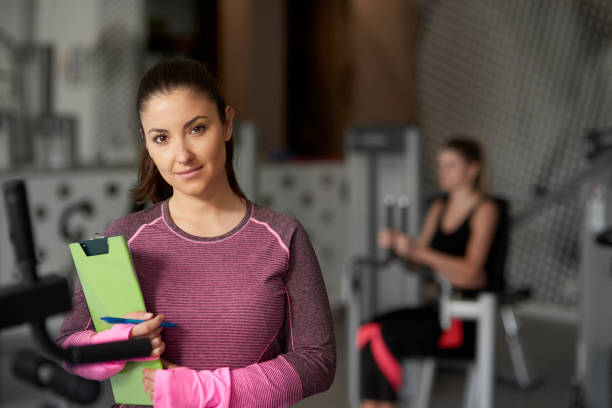 Portrait of personal trainer at the gym stock photo