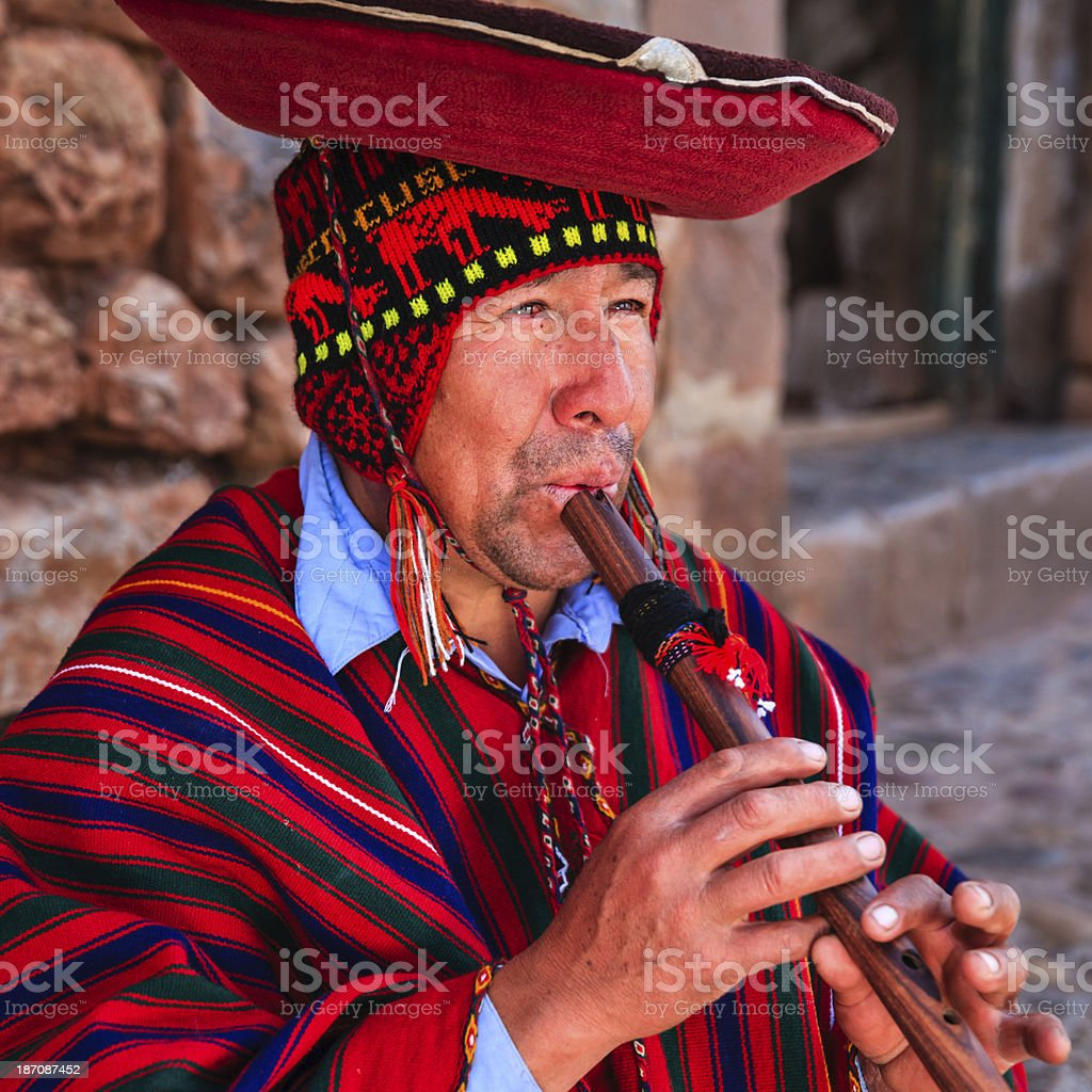 Portrait of Peruvian man playing a flute, Sacred Valley royalty-free stock photo