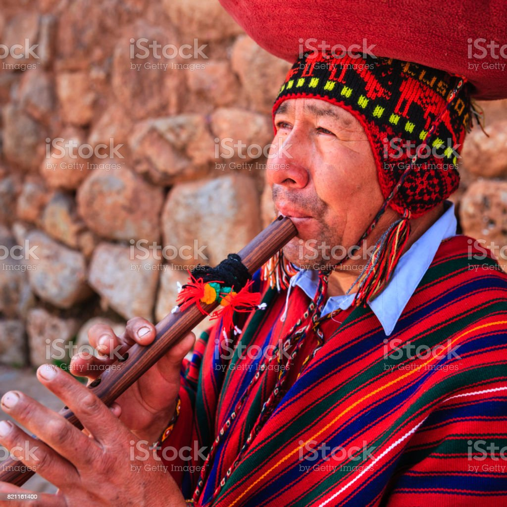 Portrait of Peruvian man playing a flute, Sacred Valley stock photo