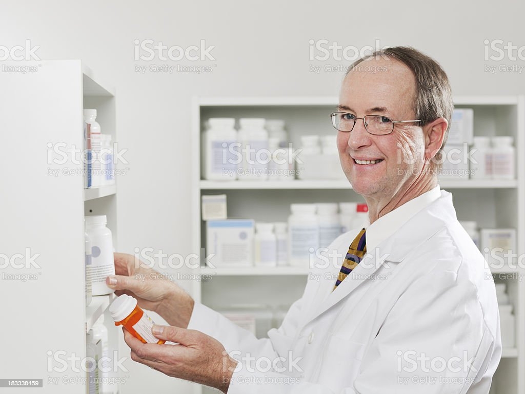 Portrait of Pharmacist in a Pharmacy Hz royalty-free stock photo