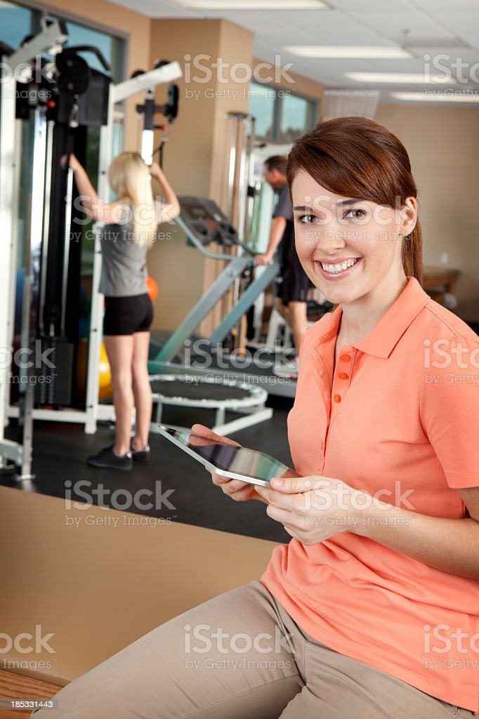 Portrait of physical therapist holding a digital tablet royalty-free stock photo
