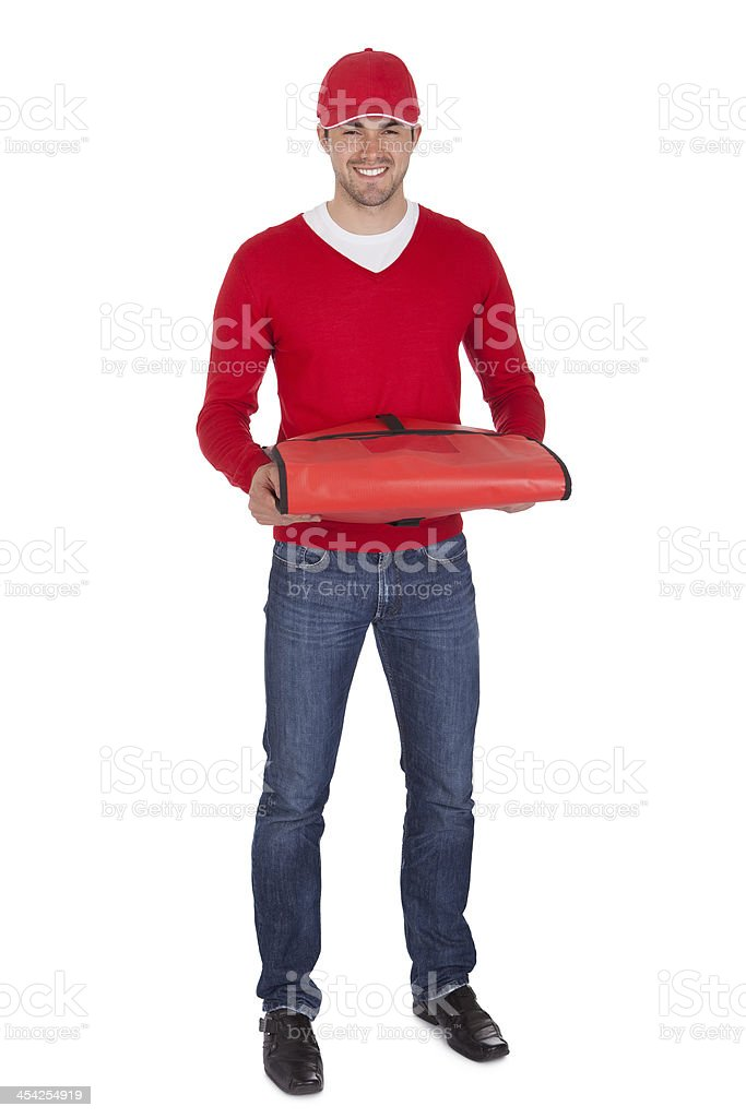Portrait of pizza delivery boy with thermal bag royalty-free stock photo