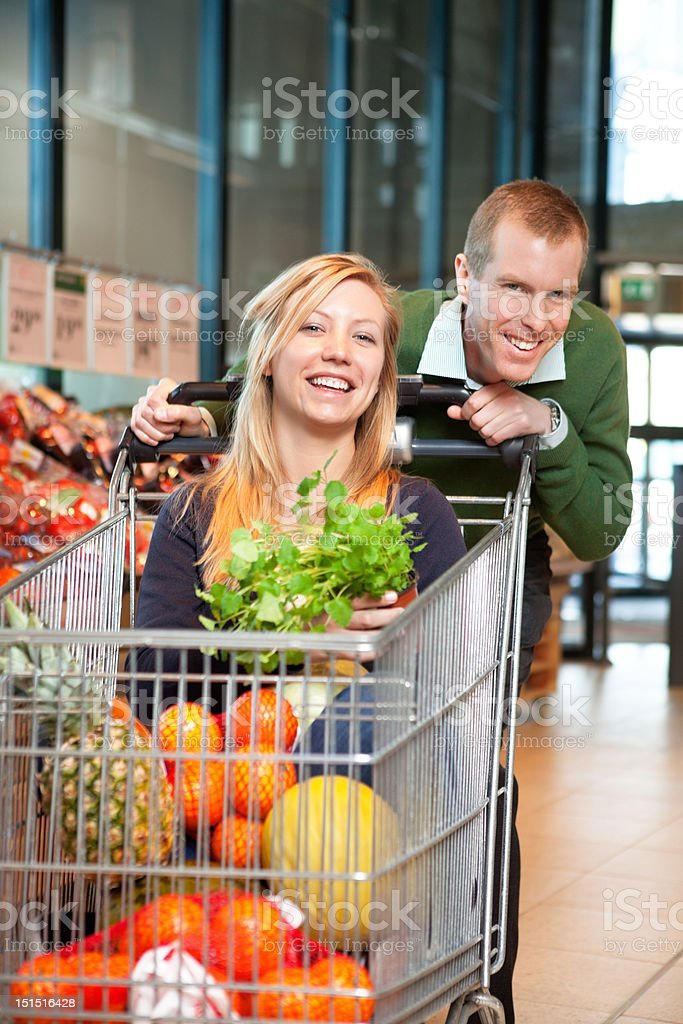 Portrait of playful couple in shopping store royalty-free stock photo