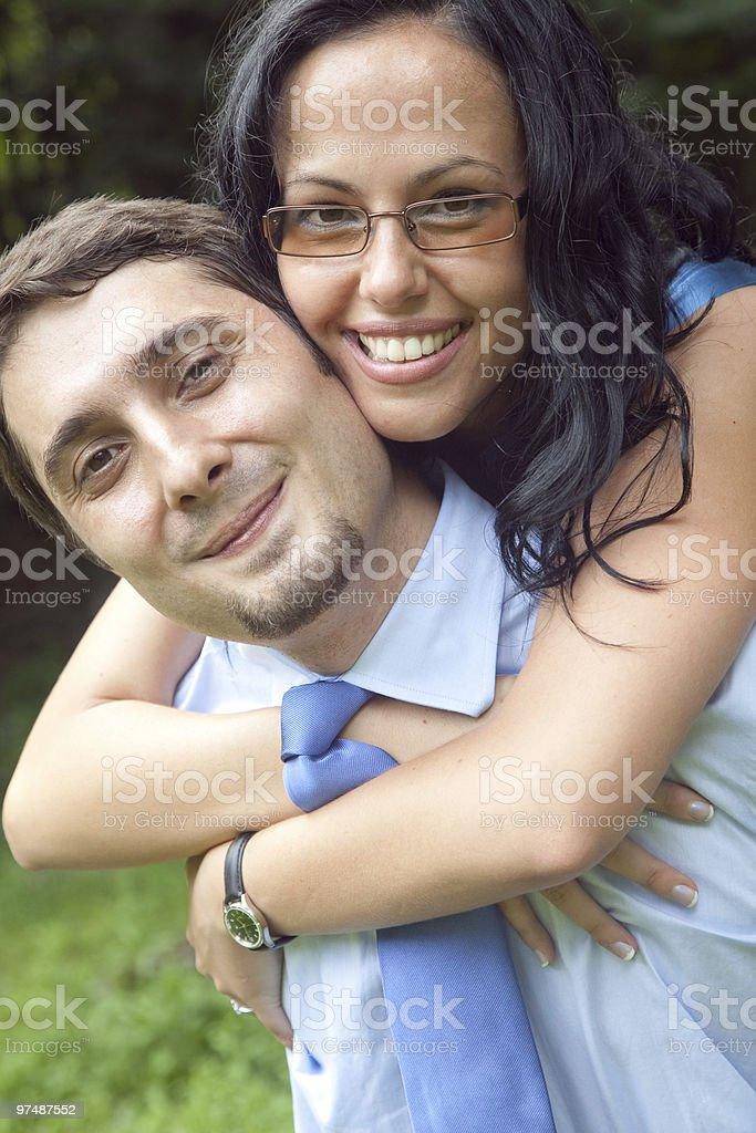 Portrait of playful cute young couple hugging royalty-free stock photo