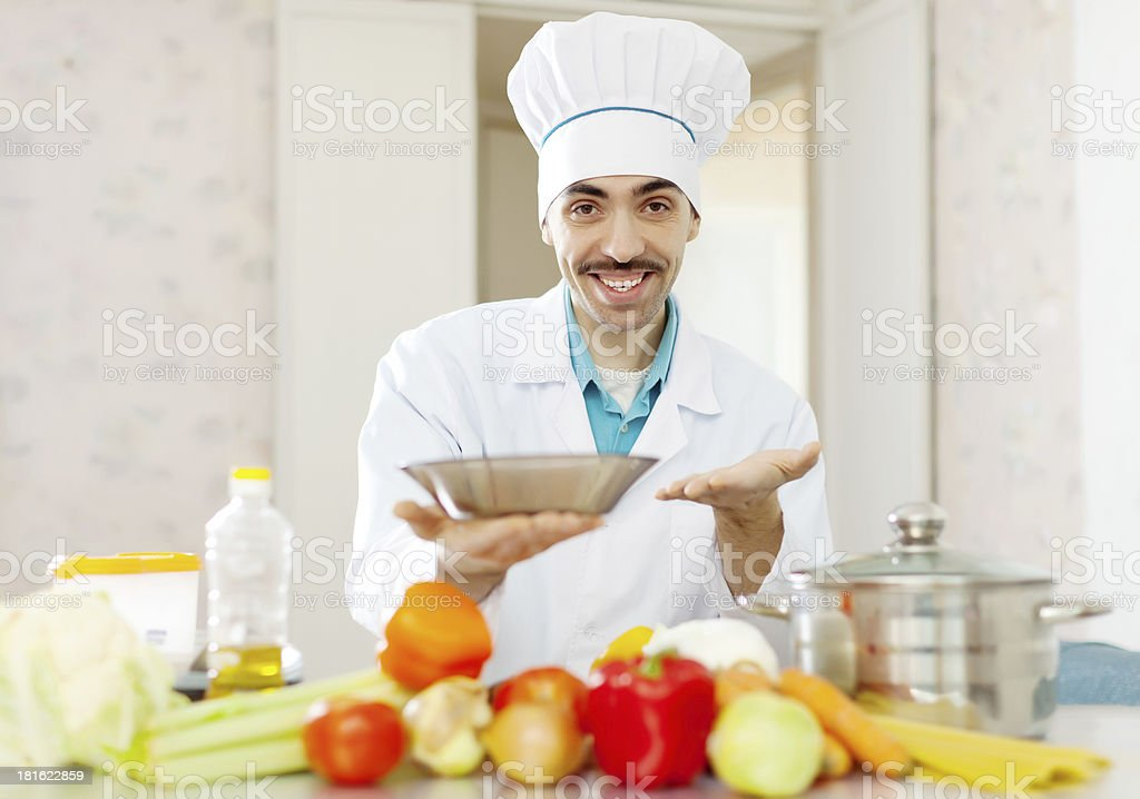 Portrait of positive caucasian male cook royalty-free stock photo