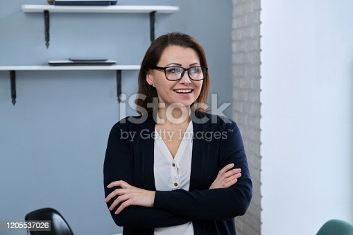 949435100 istock photo Portrait of positive confident middle aged woman with arms crossed 1205537026