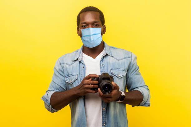 Portrait of positive photographer man with medical mask holding picture id1214077829?b=1&k=6&m=1214077829&s=612x612&w=0&h=wu7zf ot7xhkenrgqetji0naitrvtng4juebvzb4ssy=