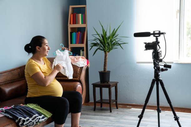 Portrait Of Pregnant Woman Vlogger In Front Of Camera stock photo