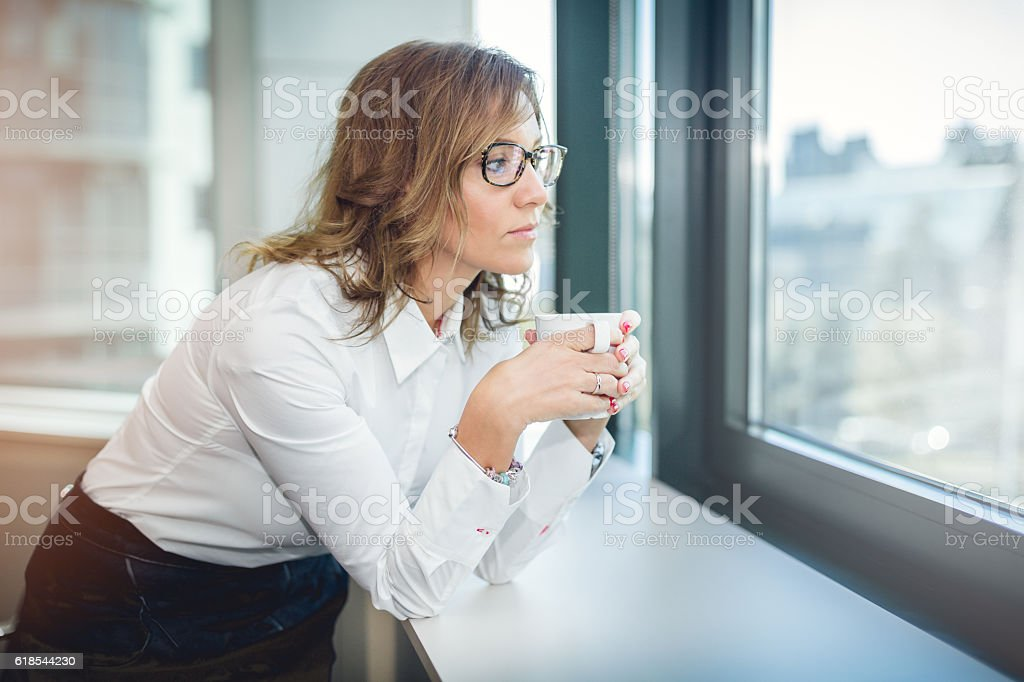 portrait of pretty business woman drinking coffee stock photo