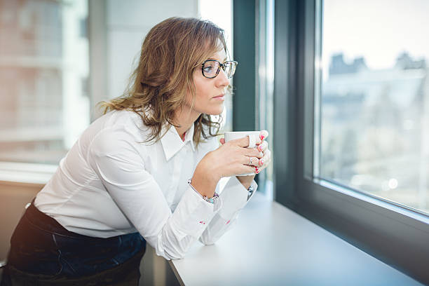 portrait of pretty business woman drinking coffee - foto de stock