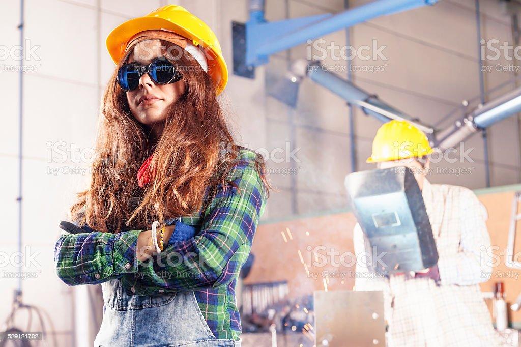 portrait of pretty female worker in a steel mill stock photo