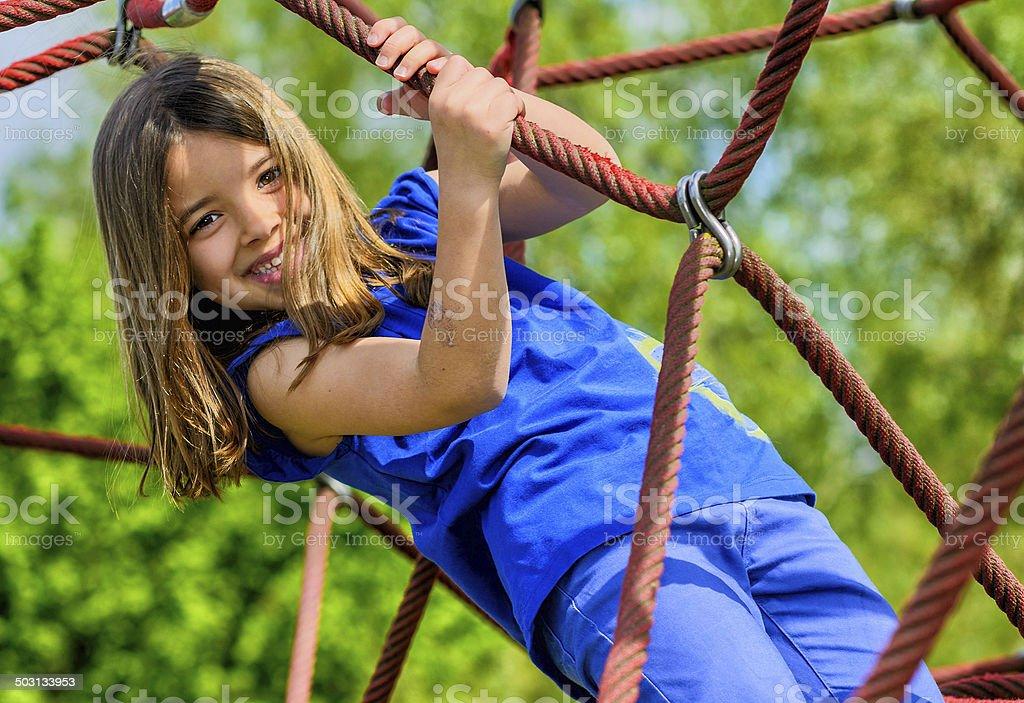 portrait of pretty girl doing rock climbing stock photo