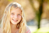 Portrait Of Pretty Girl In Countryside Smiling To Camera