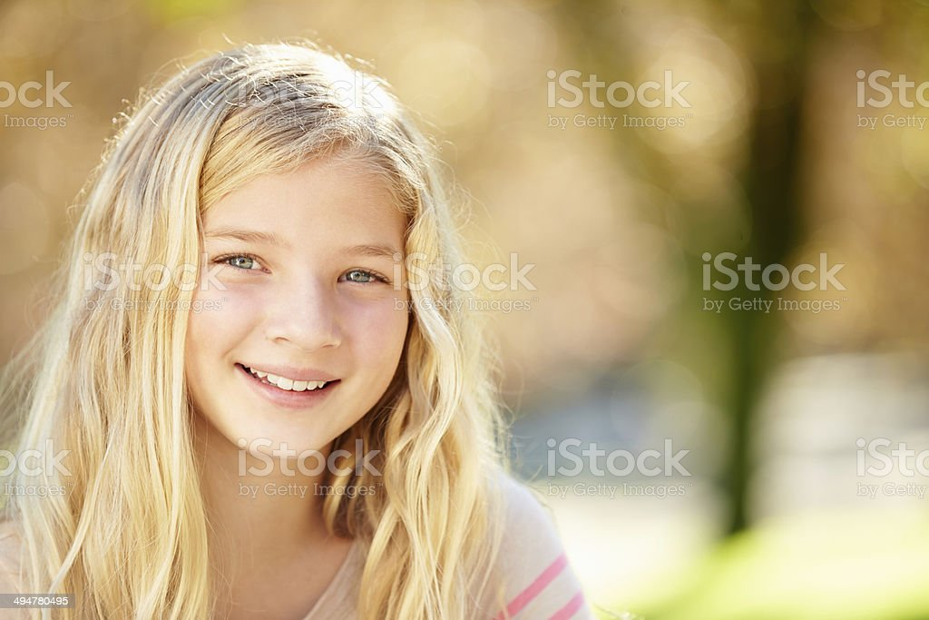 Portrait Of Pretty Girl In Countryside stock photo