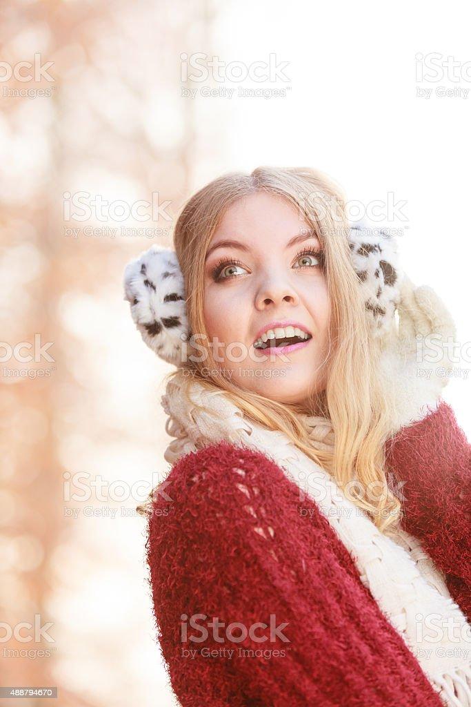 Portrait of pretty gorgeous woman in earmuffs. stock photo