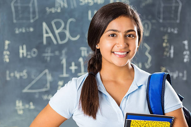 portrait of pretty indian high school student in classroom - arabic girl stock photos and pictures