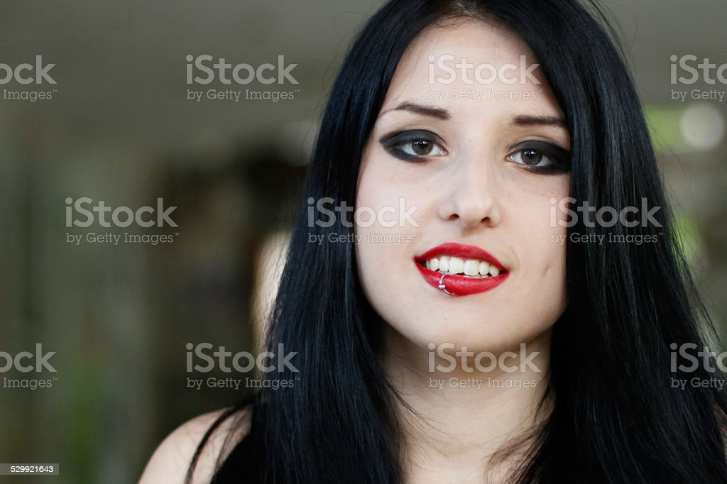 Portrait of pretty smiling girl with lip piercing stock photo
