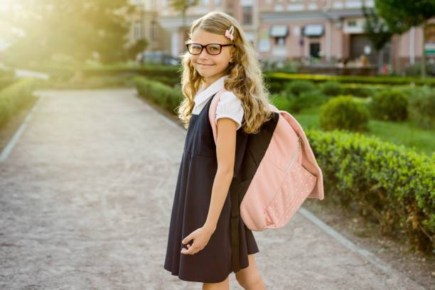 Portrait of pretty student on the way to school stock photo