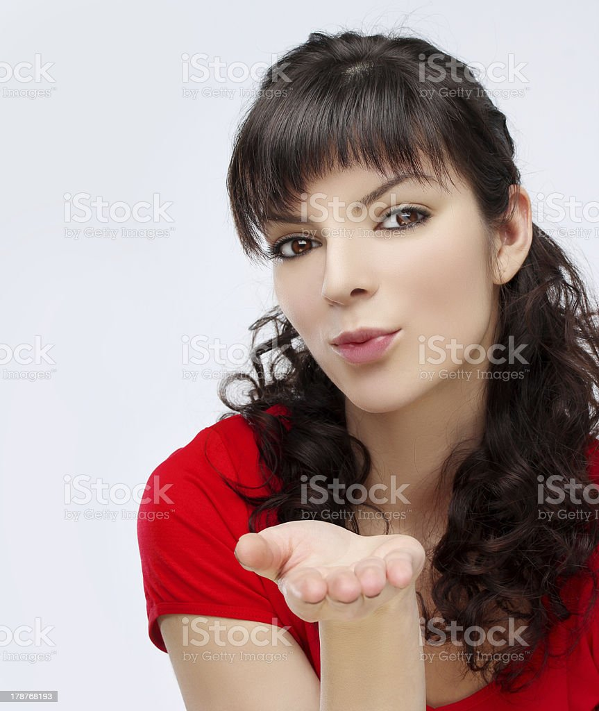 Portrait of pretty summer girl blowing kiss at the camera royalty-free stock photo