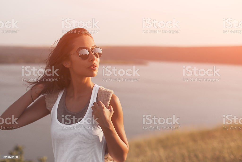 Portrait of pretty woman in sunny warm weather day. stock photo