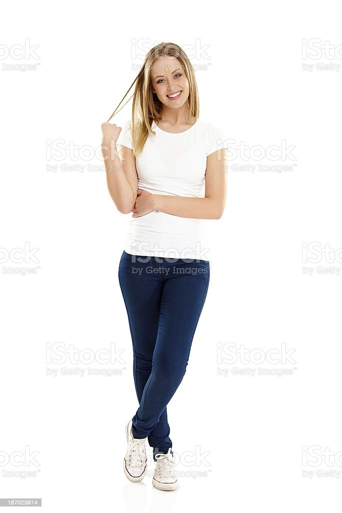 Portrait of pretty young girl standing on white royalty-free stock photo