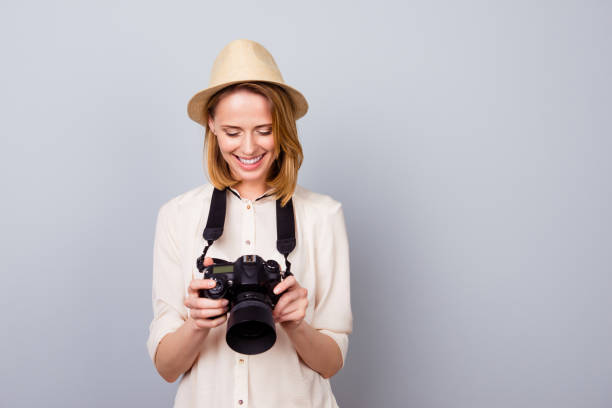 Portrait of pretty young photographer in straw hat holding camera and picture id940446442?b=1&k=6&m=940446442&s=612x612&w=0&h=sstptpjflv5 ospq9mshewa9qsj3brjdrncvigyhfxo=