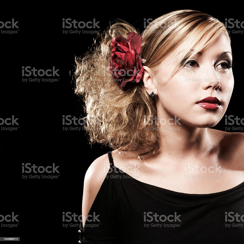 Portrait of Pretty Young Woman with Red Flower in Hair stock photo