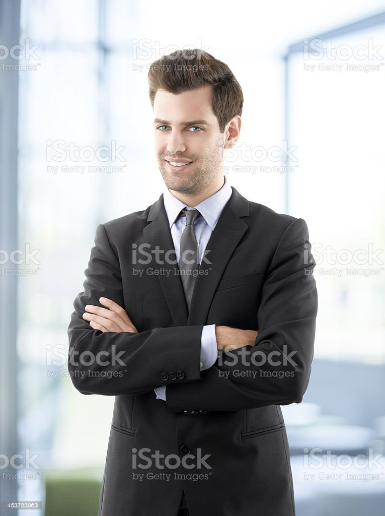 Portrait of professional smiling businessman stock photo