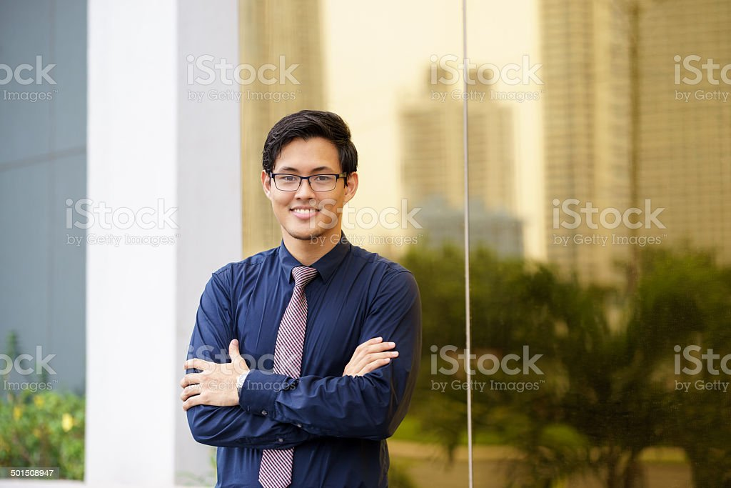 Portrait of proud and confident chinese office worker stock photo