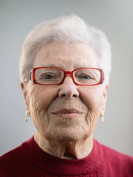 portrait of real caucasian senior woman with attitude - sud europeo foto e immagini stock