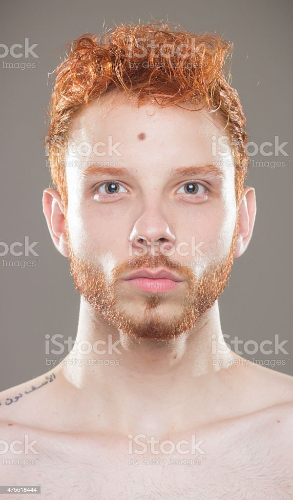 Portrait of red hair guy, having fun. stock photo