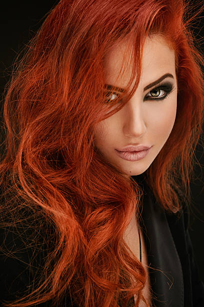 portrait of red haired woman - woman green eyes red hair stock photos and pictures