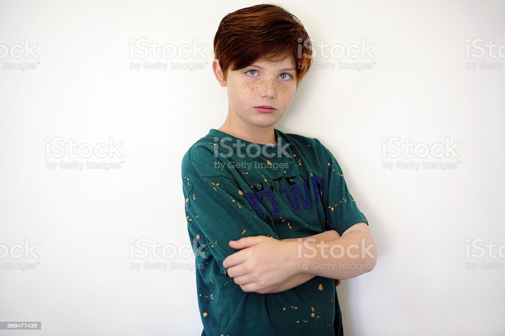 Portrait of redhead boy with freckles and green eyes stock photo