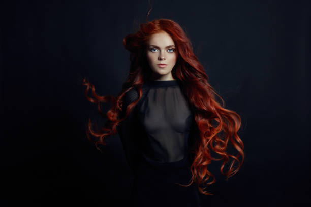 3c8913982d Portrait of redhead sexy woman with long hair on black background. Perfect  girl with the